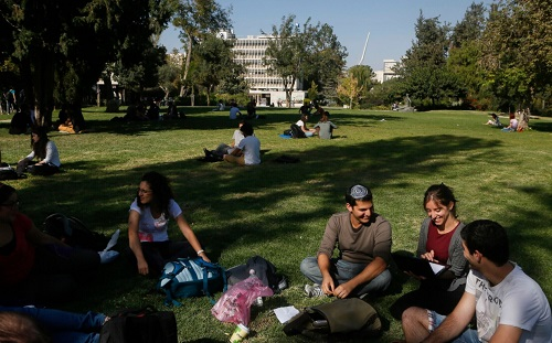 Students sitting in lawn of Hebrew University studying